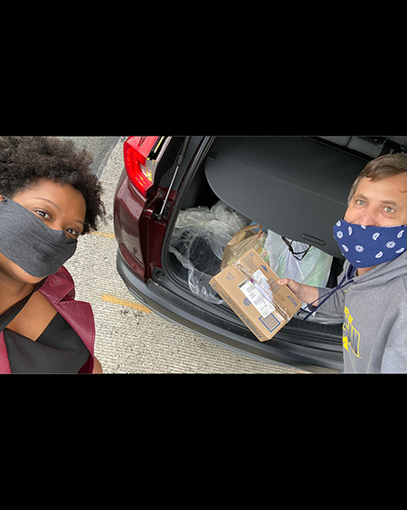 students with car full of donations